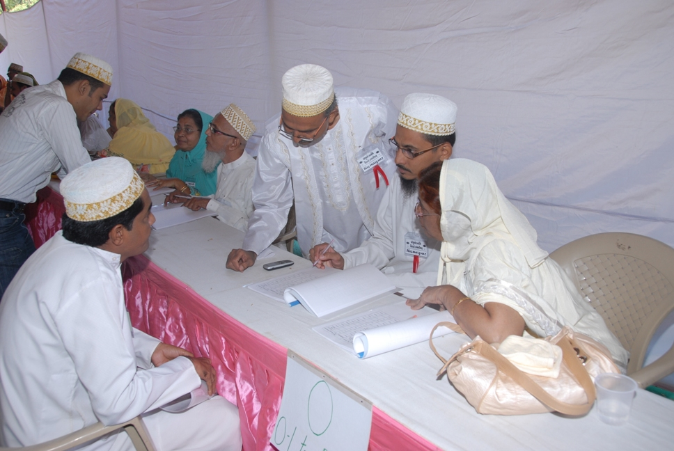 Anjuman members discussing with the participant