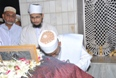 Maazoon Saheb doing the Ziyaarat of Muqaddas Maula
